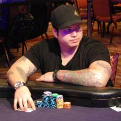 2013 World Series of Poker Main Event runner-up Jay Farber plays at one of the ESPN secondary featured tables in the Amazon Room on Day 2B of the 2014 Main Event.