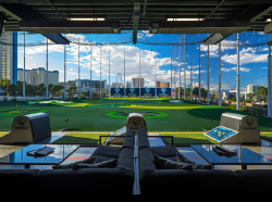 Four huge TV screens and the Las Vegas Strip serve as the backdrop at the new 150,000 square-foot venue. (photo by Topgolf Las Vegas)