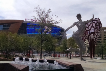 Bliss Dance, a statue by Marco Cochrane, is surrounded by fountains and trees in front of the new T-Mobile Arena.