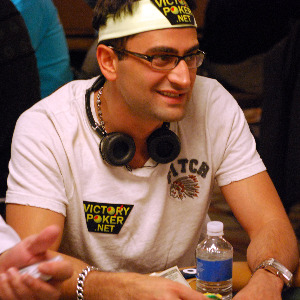 Antonio Esfandiari flashes a grin during play.