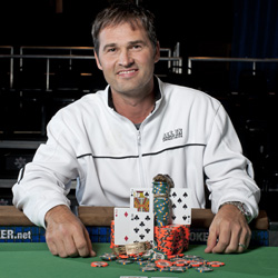Barch with his winning cards, bracelet and alligator head.