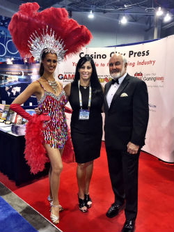 Casino City Press enticed visitors to its G2E booth with a Sean Connery look-alike and Las Vegas Showgirl.