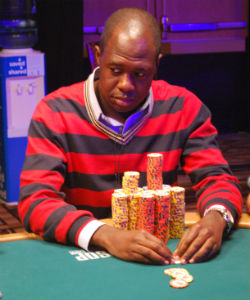 Check out the mountain of chips in front of A.J. Jejelowo. He ended the day with 928,500.