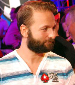Daniel Negreanu speaks to a reporter after being busted in 11th place from the WSOP Main Event.