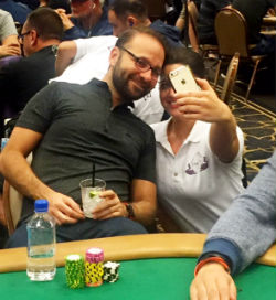 Daniel Negreanu takes a selfie with an admiring fan on Thursday night at the WSOP.