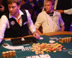Daniel Rudd looks at the 980,000-chip pot he just won.