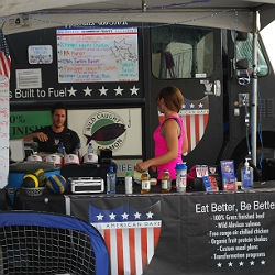 Dave Swanson, left, sits in front of his All American Dave food truck outside the Amazon Room at the Rio on Thursday afternoon.
