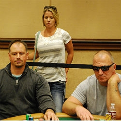 Dean Baranowski, left, plays on Day 1C of the World Series of Poker Main Event as his wife Colleen, top, looks on.