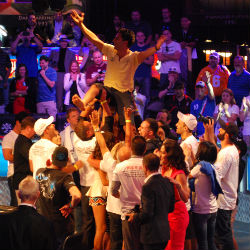 Esfandiari is hoisted in the air by friends and family after clinching the Big One for One drop title.