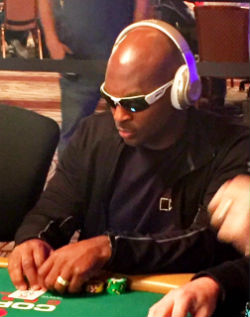 Former Minnesota Viking Antoine Winfield kills time in between hands at the WSOP by playing online chess with Adrian Peterson.