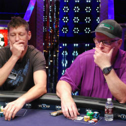 Huck Seed, left, and Dan Harrington, right, the 1996 and 1995 Main Event champions, respectively, play together on Day 1B.