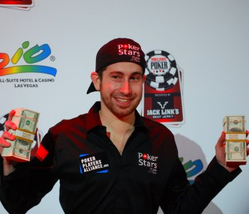 Jonathan Duhamel holds some of the $8,944,310 he collected for winning the WSOP Main Event.
