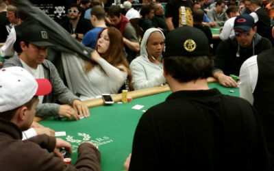 Marco Rodriguez (left, black hat) plays on Day 1C of the 2015 WSOP Main Event with Melanie Weisner (center), Phil Ivey (right) and Phil Hellmuth (center, backwards).
