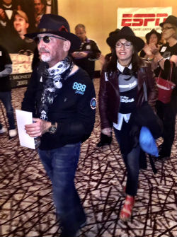 Neil Blumenfield and his girlfriend Pascale Elsair walk through the crowd following his elimination from the WSOP Main Event.