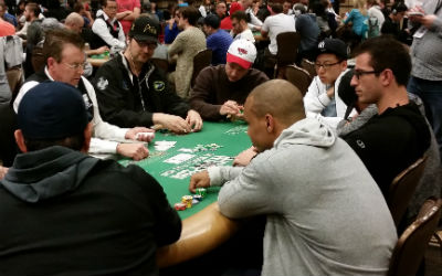 Phil Hellmuth (left) and Phil Ivey (right, backwards) played at the same table on Day 1C of the 2015 WSOP Main Event.