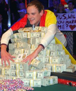 Pius Heinz shows off the spoils of victory after winning the 2011 World Series of Poker Main Event.