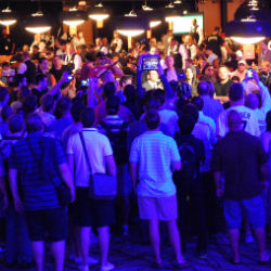 Players at the Main Event celebrate making the money Friday.