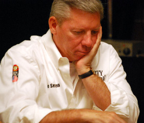 Recent WSOP Hall of Famer Mike Sexton ponders a call.