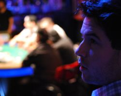 Ryan Kostiuk speculates what his father might be holding while sitting at the ESPN feature table.