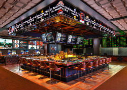 The 23-seat bar at The Cosmo sportsbook is open 24/7 and offers unobstructed sightlines to the main LED walls. (photo by © Erik Kabik/ erikkabik.com)