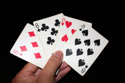 The first player who discards all of his cards in Crazy Eights wins the game.