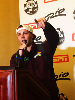 Tom Cannuli gestures to his supporters on Monday night, moments after he was sent to the rail following a brutal bad beat at the WSOP Main Event final table.