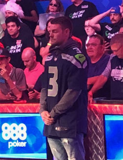 Tony Miles steps away from the table to meditate before play began at the WSOP Main Event on Thursday.